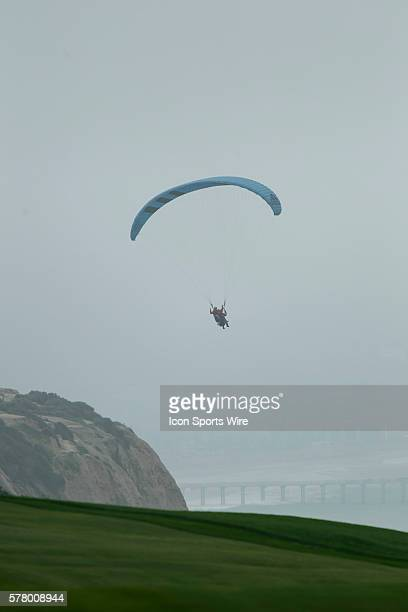 Para gliders watch play on the 4th hole on the Torrey Pines Golf Course during the final round of the Farmers Insurance Open in San Diego Ca