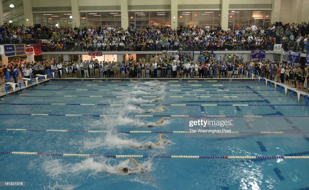 A packed house watches the Girls 50 Yard freestyle race during action in the Washington Metropolitan Swimming & Diving Championships on February 9, 2013 in Boyds, MD