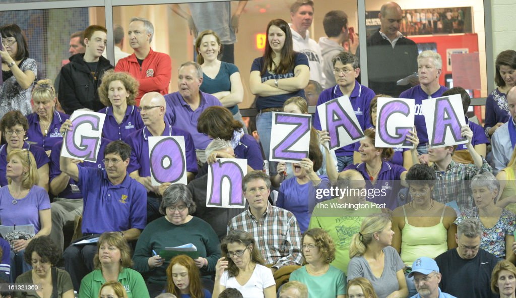 Parents and fans for Gonzaga show their pride during action in the Washington Metropolitan Swimming & Diving Championships on February 9, 2013 in Boyds, MD