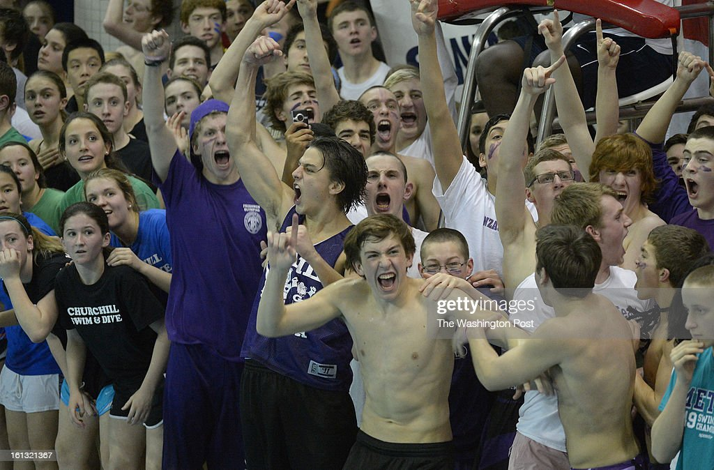 The Gonzage student section erupts at victory in the Boys 200 yard freestyle event as the Churchill students look at the clock during action in the Washington Metropolitan Swimming & Diving Championships on February 9, 2013 in Boyds, MD