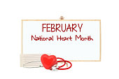 February National Heart Month white board stethoscope red heart electrocardiograph