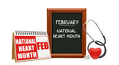 February National Heart Month calendar blackboard with red heart, stethoscope white background