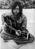 FebruaryMarch 1968 John LENNON playing the guitar in Rishikesh India where he was following a transcendental course with the rest of the BEATLES...