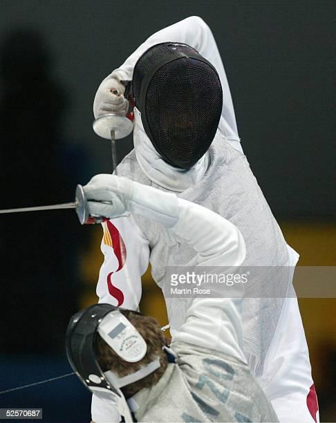 Fechten Olympische Spiele Athen 2004 Athen Florett / Mannschaft / Maenner Finale ITA / CHN Ye CHONG / CHN / Silber Salvatore SANZO / ITA / Gold 210804