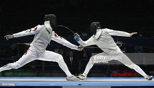 Fechten Olympische Spiele Athen 2004 Athen Florett / Mannschaft / Maenner Finale ITA / CHN Hanxiong WU / CHN Simone VANNI / ITA 210804