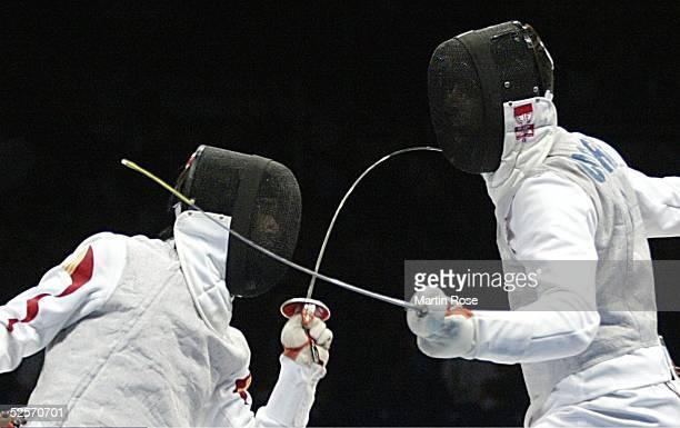 Fechten Olympische Spiele Athen 2004 Athen Florett / Mannschaft / Maenner Finale Italien China Chong YE / CHN Andrea CASSARA / ITA 210804