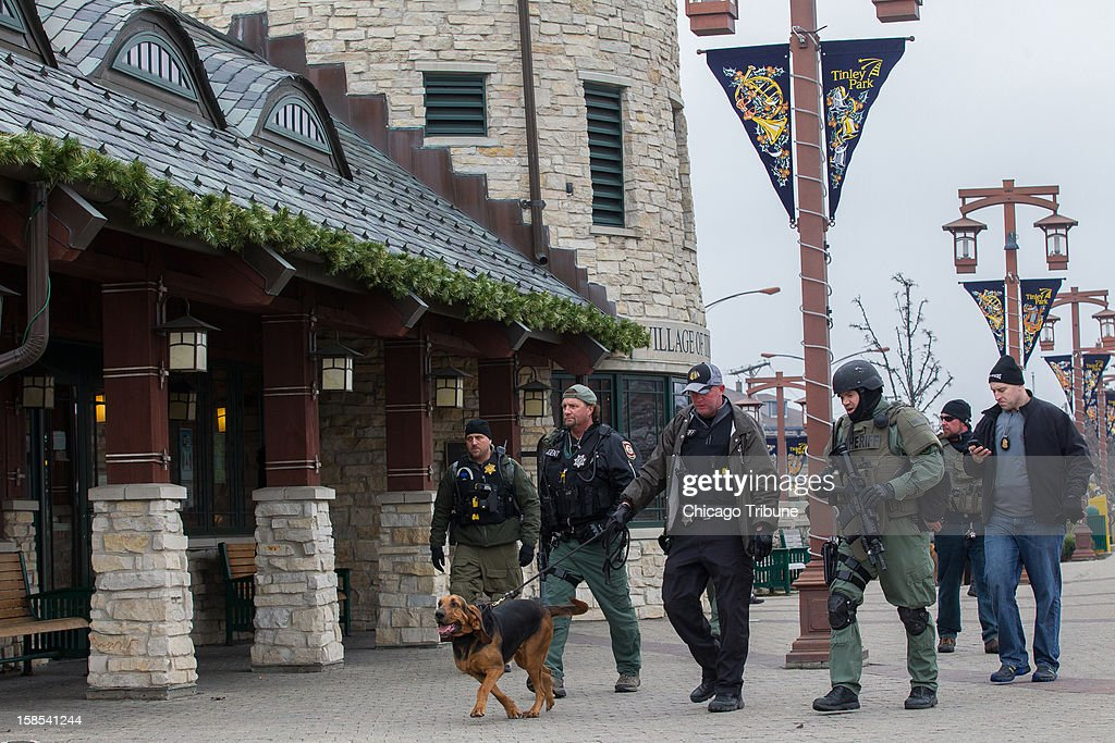 Federal agents and the Cook County Sheriff SWAT team use dogs to search for prisoners who escaped from the federal Metropolitan Correctional Center in Chicago, Illinois on Tuesday, December 18, 2012.