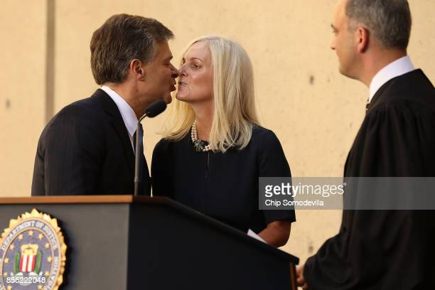 Federal Bureau of Investigation Director Christopher Wray kisses his wife Helen Wray after being ceremonially sworn in to office by US District Court...