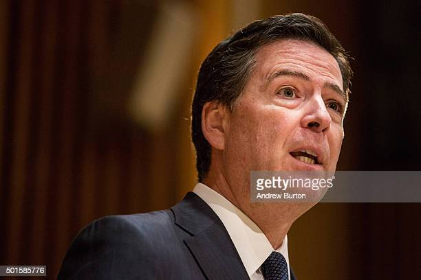 Federal Bureau of Investigation Director James Comey answers questions at a press conference after speaking at the New York Police Department Shield...