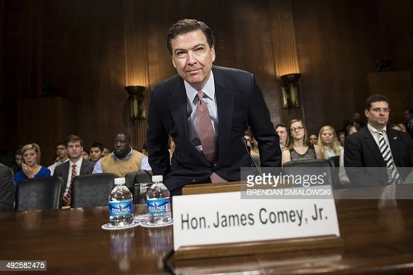 Federal Bureau of Investigation Director James Comey arrives for a hearing of the Senate Judiciary Committee on Capitol Hill May 21 2014 in...