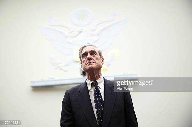 Federal Bureau of Investigation Director Robert Mueller arrives at a hearing before the House Judiciary Committee June 13 2013 on Capitol Hill in...