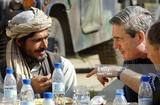 Federal Bureau of Investigation Director Robert Mueller has lunch with Haji Gulali commander of the Kandahar region on the American military compound...