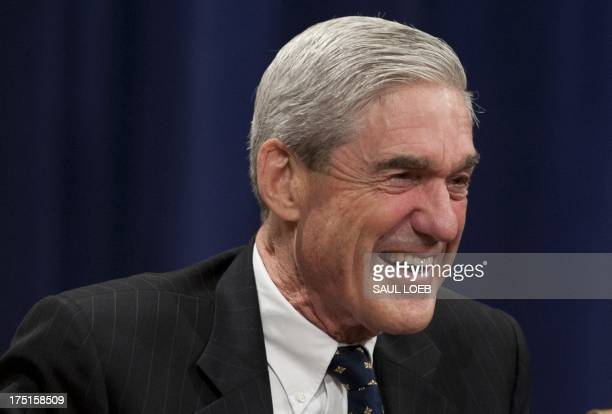 Federal Bureau of Investigation Director Robert Mueller laughs during a farewell ceremony in his honor at the Department of Justice on August 1 2013...