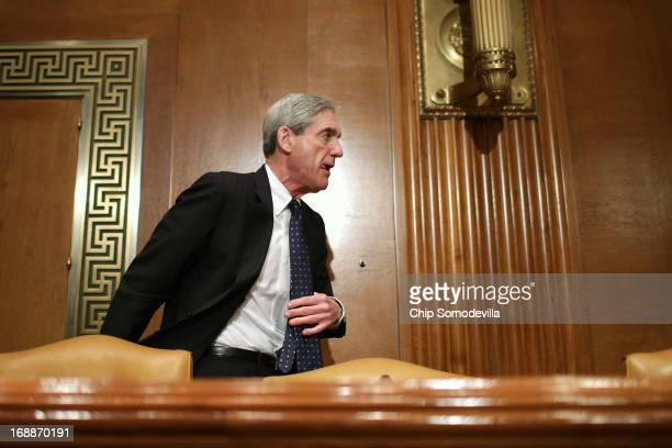 Federal Bureau of Investigation Director Robert Mueller moves to a closed hearing of the Senate Appropriations Committee's Commerce Justice Science...