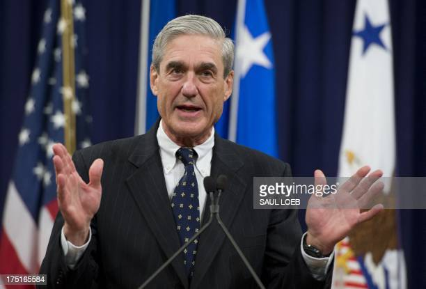 Federal Bureau of Investigation Director Robert Mueller speaks during a farewell ceremony in Mueller's honor at the Department of Justice on August 1...