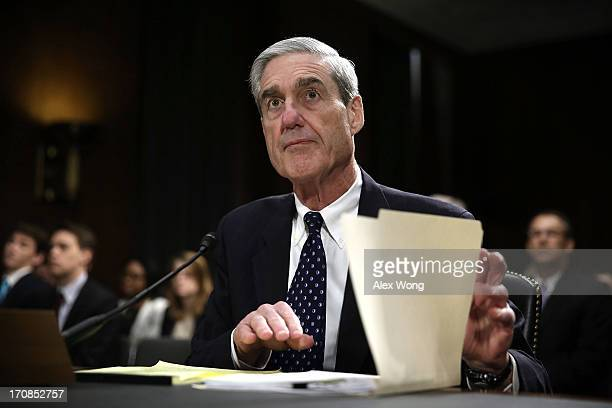 Federal Bureau of Investigation Director Robert Mueller waits for the beginning of a hearing before the Senate Judiciary Committee June 19 2013 on...