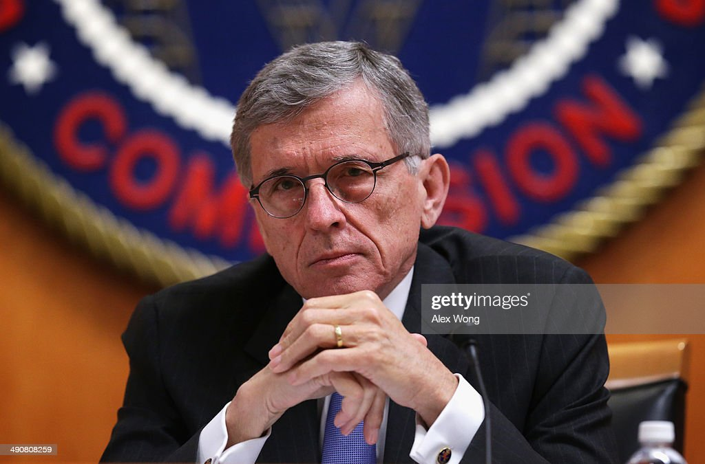 Federal Communications Commission (FCC) Chairman Tom Wheeler listens during an open meeting to receive public comment on proposed open Internet notice of proposed rulemaking and spectrum auctions May 15, 2014 at the FCC headquarters in Washington, DC. The FCC has voted in favor of a proposal to reform net neutrality and could allow Internet service providers to charge for faster and higher-quality service.