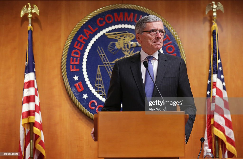 Federal Communications Commission (FCC) Chairman Tom Wheeler listens during a news conference after an open meeting to receive public comment on proposed open Internet notice of proposed rulemaking and spectrum auctions May 15, 2014 at the FCC headquarters in Washington, DC. The FCC has voted in favor of a proposal to reform net neutrality and could allow Internet service providers to charge for faster and higher-quality service.
