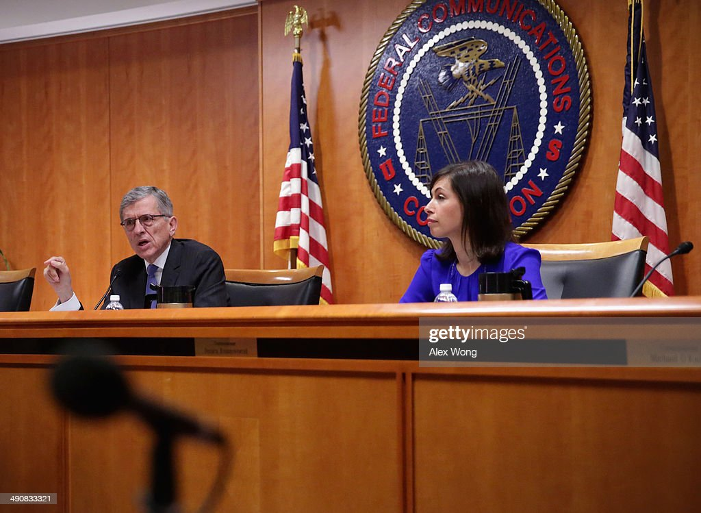 Federal Communications Commission (FCC) Chairman Tom Wheeler (L) speaks as commissioner Jessica Rosenworcel (R) listens during an open meeting to receive public comment on proposed open Internet notice of proposed rulemaking and spectrum auctions May 15, 2014 at the FCC headquarters in Washington, DC. The FCC has voted in favor of a proposal to reform net neutrality and could allow Internet service providers to charge for faster and higher-quality service.