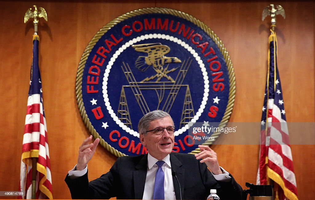 Federal Communications Commission (FCC) Chairman Tom Wheeler speaks during an open meeting to receive public comment on proposed open Internet notice of proposed rulemaking and spectrum auctions May 15, 2014 at the FCC headquarters in Washington, DC. The FCC has voted in favor of a proposal to reform net neutrality and could allow Internet service providers to charge for faster and higher-quality service.