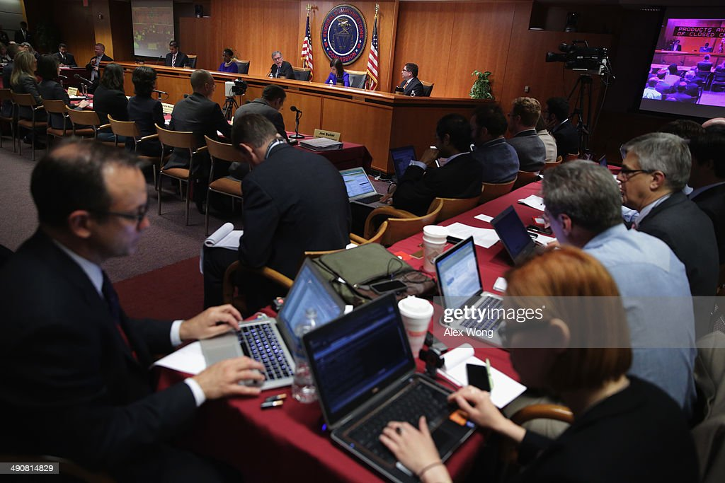 Federal Communications Commission (FCC) Chairman Tom Wheeler (C) speaks during an open meeting to receive public comment on proposed open Internet notice of proposed rulemaking and spectrum auctions May 15, 2014 at the FCC headquarters in Washington, DC. The FCC has voted in favor of a proposal to reform net neutrality and could allow Internet service providers to charge for faster and higher-quality service.