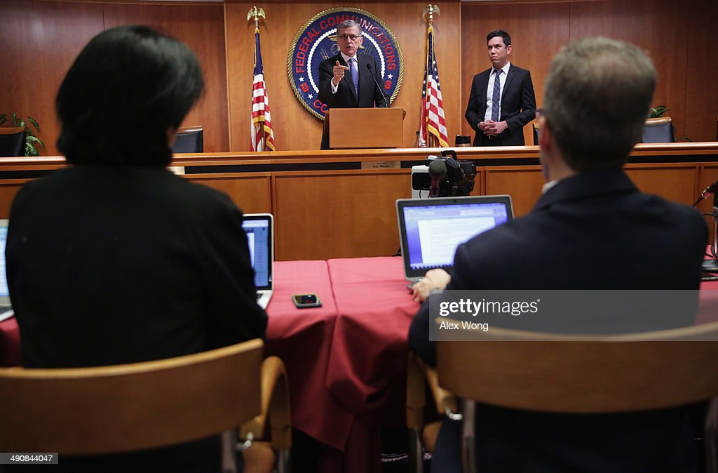 Federal Communications Commission (FCC) Chairman Tom Wheeler (C) speaks during a news conference after an open meeting to receive public comment on proposed open Internet notice of proposed rulemaking and spectrum auctions May 15, 2014 at the FCC headquarters in Washington, DC. The FCC has voted in favor of a proposal to reform net neutrality and could allow Internet service providers to charge for faster and higher-quality service.