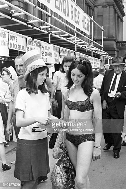 1966 Federal Election A girl in a bikini causes quite a stir among other voters preparing to cast their ballots at the Sydney Town Hall during the...