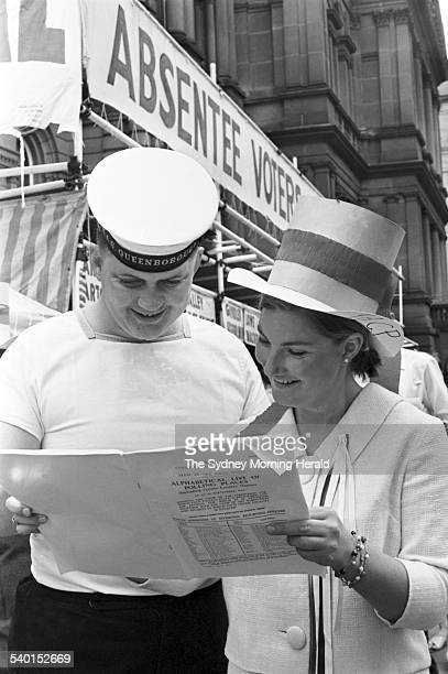 1966 Federal Election A sailor from the HMAS Queensborough is guided through a how to vote pamphlet before casting his vote outside the Sydney Town...