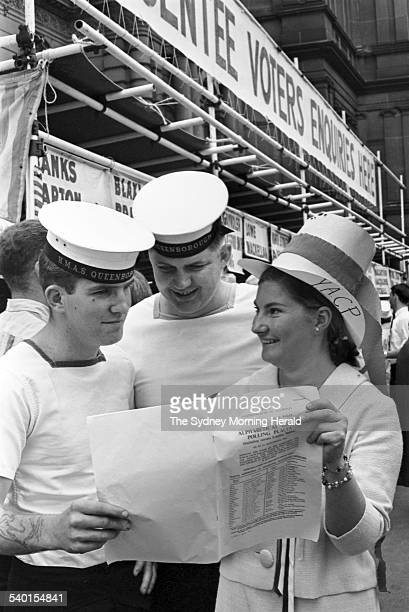 1966 Federal Election Two sailors from the HMAS Queensborough prepare to cast their ballot outside the Sydney Town Hall during the 1966 Federal...