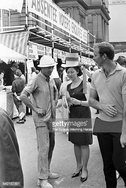 1966 Federal Election Voters outside the Sydney Town Hall prepare to cast their ballot during the 1966 Federal Election which sees Harold Holt's...