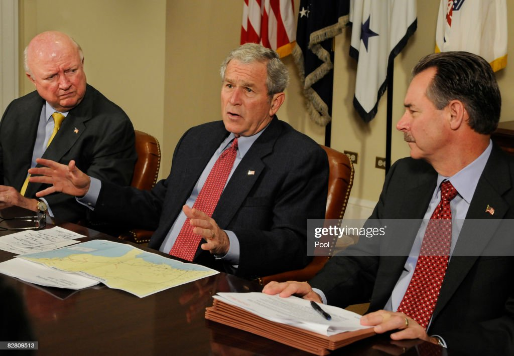 Federal Emergency Management Agency Administrator David Paulison (R) and Energy Secretary Samuel Bodman (L) listen as U.S. President George W. Bush (C) briefs the press on relief efforts in the aftermath of Hurricane Ike at the White House September 14, 2008 in Washington, DC. Ike caused extensive damage along the Texas Gold Coast, leaving millions without power.