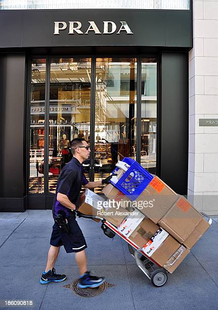 Federal Express package deliveryman passes in front of the Prada store in San Francisco's upscale Union Square shopping area on October 4 2013 in San...