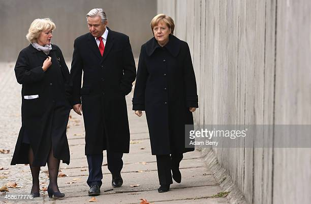 Federal Government Commissioner for Culture and the Media Monika Gruetters Berlin Mayor Klaus Wowereit and German Chancellor Angela Merkel walk along...