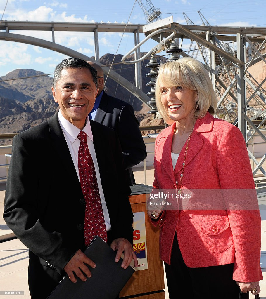 Federal Highway Administration Administrator Victor Mendez (L) talks with Arizona Gov. Jan Brewer at the dedication of the Mike O'Callaghan-Pat Tillman Memorial Bridge part of the Hoover Dam Bypass Project October 14, 2010 in the Lake Mead National Recreation Area, Nevada. The 1,900-foot-long structure sits 890 feet above the Colorado River, about a quarter of a mile downstream from the Hoover Dam. The USD 240 million project to relieve vehicle traffic on the Hoover Dam began in 2003, and is scheduled to be open to traffic by next week.