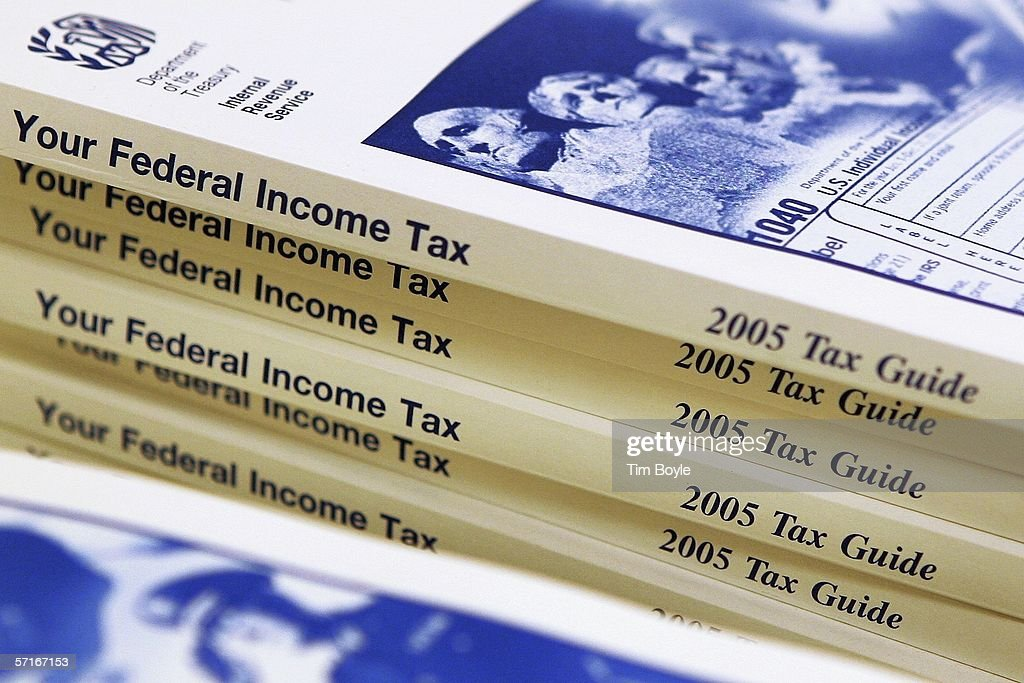 Federal income tax guides for 2005 are seen at the Des Plaines Public Library March 23, 2006 in Des Plaines, Illinois. As next month's income tax deadline approaches, Americans are preparing for it by using tax software, filing out paper forms or by using a tax preparer.