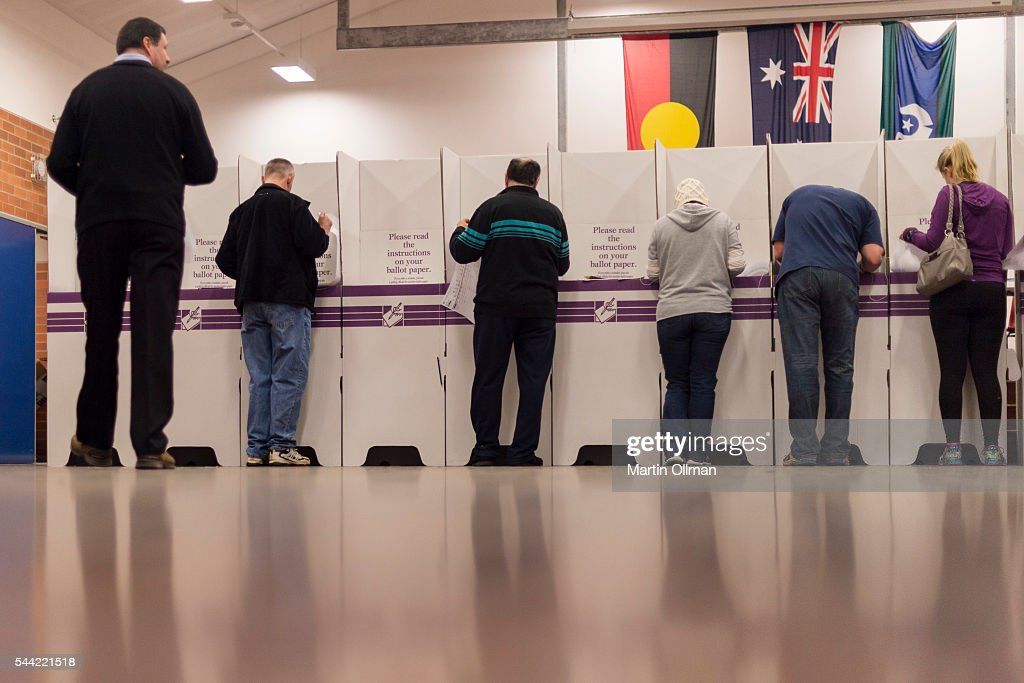 Federal Labor's candidate for Eden Monaro Mike Kelly (far left) votes in the electorate of Eden-Monaro on July 2, 2016 in Canberra, Australia. Voters head to the polls today to elect the 45th parliament of Australia.
