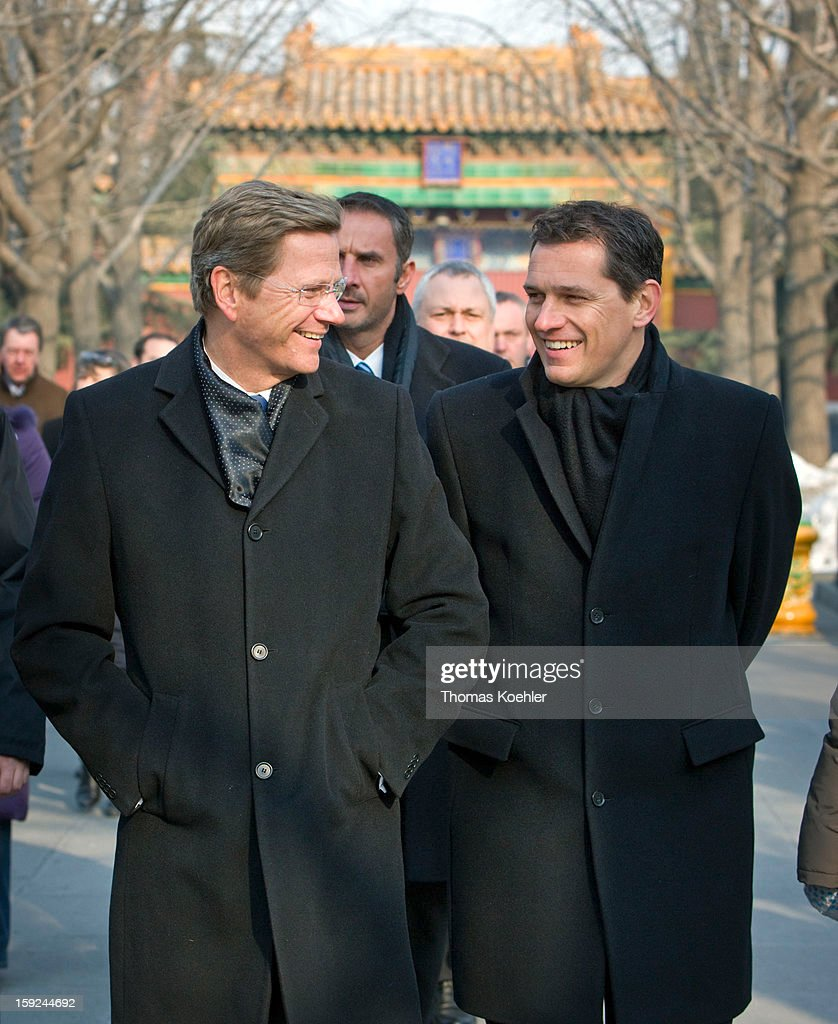 Federal Minister for Foreign Affairs of Germany and Vice-Chancellor and member of the Free Democratic Party <a gi-track='captionPersonalityLinkClicked' href=/galleries/search?phrase=Guido+Westerwelle&family=editorial&specificpeople=208748 ng-click='$event.stopPropagation()'>Guido Westerwelle</a> and his partner <a gi-track='captionPersonalityLinkClicked' href=/galleries/search?phrase=Michael+Mronz&family=editorial&specificpeople=762924 ng-click='$event.stopPropagation()'>Michael Mronz</a> are visiting the Lama Temple, Janaury 16, 2010 in Beijing, China.