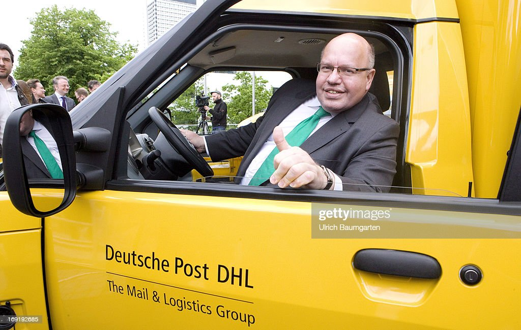 Federal Minister of Environment Peter Altmaier (CDU) sits in a carbon-neutral mail delivery vehicle on May 21, 2013 in Bonn, Germany. Initially 79 vehicles will be put into service in Bonn and the surrounding area for delivery.