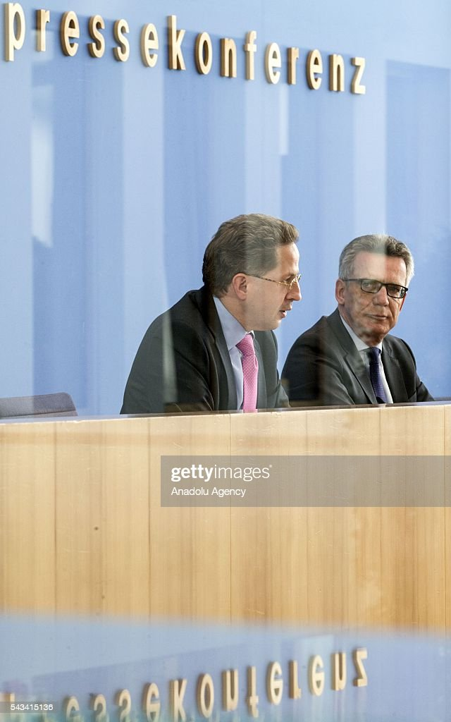 Federal Minister of the Interior of Germany, Thomas de Maiziere (R) and President of the Constitution Protection Agency, Hans-Georg Maassen (L) present the Constitution Protection Agency's 2015 report, at Federal Press Center, in Berlin, Germany on June 28, 2016.