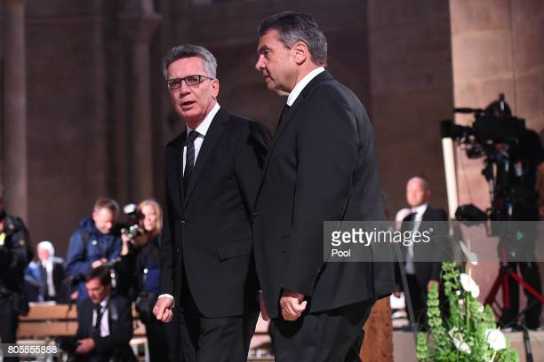 Federal Minister of the Interior Thomas de Maiziere left and Federal Foreign Minister Sigmar Gabriel attend the requiem for former German Chancellor...