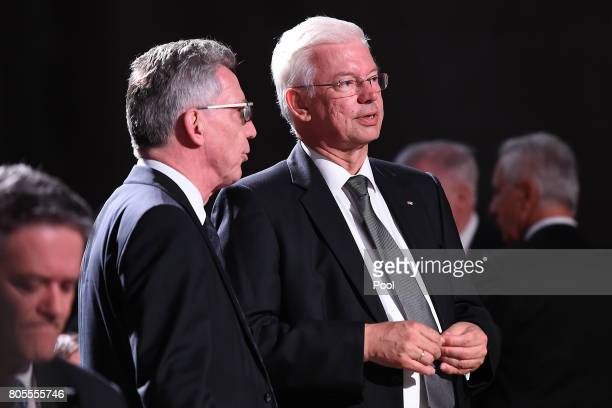 Federal Minister of the Interior Thomas de Maiziere left and President of the Hesse Roland Koch attend the requiem for former German Chancellor...
