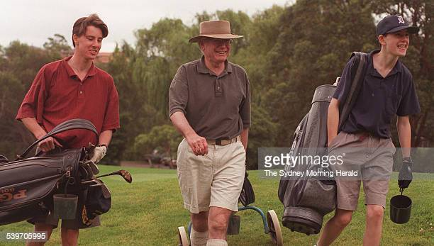 Federal Opposition Leader John Howard relaxes on the golf course for a quick game with his children Tim and Richard at Castle Cove Country Club 21...