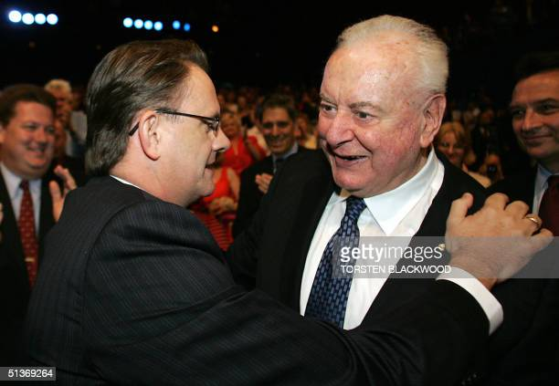 Federal opposition leader Mark Latham and former Labor prime minister Gough Whitlam embrace at the Labor Party campaign launch in Brisbane 29...