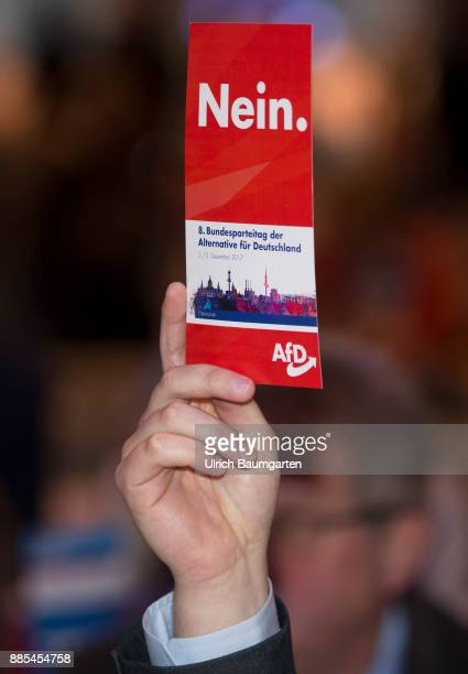 Federal Party Congress of Alternative for Germany Hand of a delegate with a red AfD vote card with the word NO