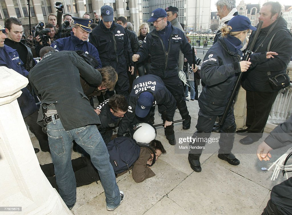 Federal police arrests right wing Flemisch anti Royalists (Vlaams Belang) in front of St G?dule Cathedral before the Te Deum , on Kings Day on November 15, 2007 in Brussels, Belgium.