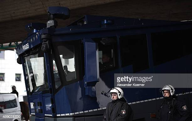 Federal police forces stand by a watercannon by the central Trainstation Hanover on November 15 2014 in Hanover Germany HoGeSa which stands for...
