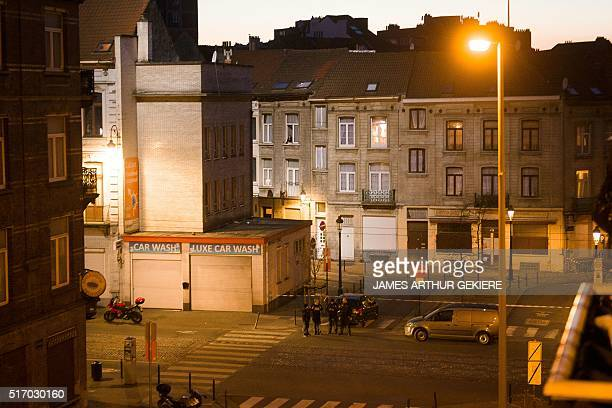 A federal police helicopter shines light on roofs on March 22 2016 inside a security perimeter set by policeme at the Place Princesse Elisabeth in...