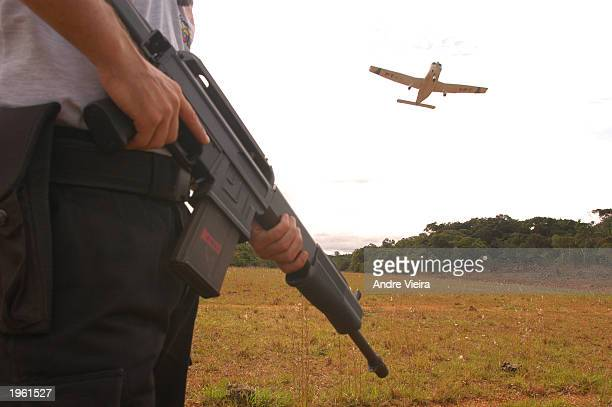 A federal police officer from Brazil secures landing strip at the Melo Franco forward base April 29 2003 in Melo Franco Brazil The base is located in...