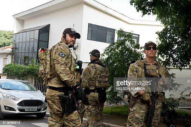 Federal police officers are deployed at the Lula Institute headquarters in Sao Paulo Brazil on March 04 2016 Police searched the home of Brazil's...
