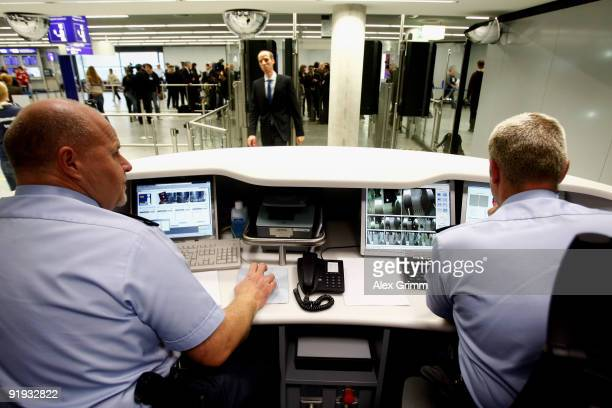 Federal police officers control the passenger data during the presentation of the new automated border control system easyPass at Frankfurt...